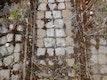Pflastersteine (Bestand) werden in die Relikt-Intarsien wieder eingebaut