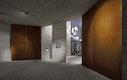 Cortenstahl, Sichtbeton und Granitpflaster - archaische Materialien im Eingangsbereich
