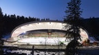 Historical natural ice stadium with new construction of a roof structure